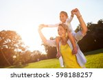 cheerful mother with daughter... | Shutterstock . vector #598188257
