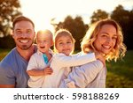 happy young parents with... | Shutterstock . vector #598188269