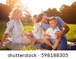 happy children with parents in... | Shutterstock . vector #598188305