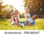 family with children blow soap... | Shutterstock . vector #598188347