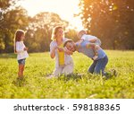 father piggyback young boy in... | Shutterstock . vector #598188365