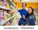 beautiful couple doing grocery... | Shutterstock . vector #598189469