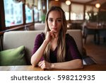 woman in a cafe or restaurant | Shutterstock . vector #598212935