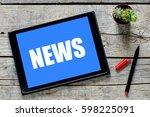 news inscription  tablet pc... | Shutterstock . vector #598225091