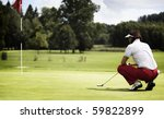 Female Golf Player With Putter...