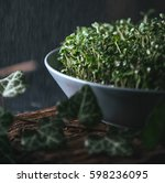 microgreen in a gray dish on a... | Shutterstock . vector #598236095