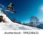 snowboarder is jumping with... | Shutterstock . vector #598238621