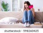 broken woman heart in... | Shutterstock . vector #598260425