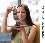 Small photo of Young girl thinking of career ladder