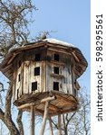Old Wooden Dovecote On Blue Sk...