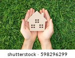wooden house on green grass  ... | Shutterstock . vector #598296299