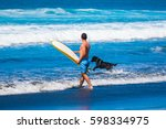 riding the waves. costa rica ... | Shutterstock . vector #598334975