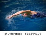 young woman swimmer in pool | Shutterstock . vector #598344179