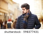 young handsome man is enjoying... | Shutterstock . vector #598377431