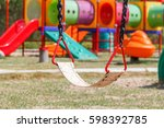 swings in colorful playground. | Shutterstock . vector #598392785