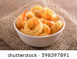 corn rings on a wooden... | Shutterstock . vector #598397891