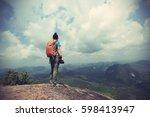 successful woman hiker hiking... | Shutterstock . vector #598413947