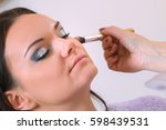 make up artist applying... | Shutterstock . vector #598439531