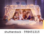 young woman and cute children... | Shutterstock . vector #598451315