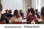 female speaker giving... | Shutterstock . vector #598469045