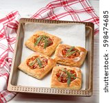 homemade pies of puff pastry... | Shutterstock . vector #598474685
