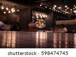 empty wood table top on blur... | Shutterstock . vector #598474745