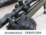 a man shoots a rifle. rifle... | Shutterstock . vector #598491584