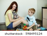 a child with her mother is... | Shutterstock . vector #598495124