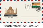 an envelope with a postage... | Shutterstock .eps vector #598526264
