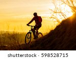 silhouette of enduro cyclist... | Shutterstock . vector #598528715