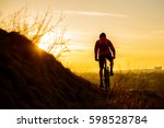 Silhouette Of Enduro Cyclist...