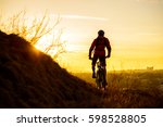 silhouette of enduro cyclist... | Shutterstock . vector #598528805