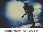 silhouette of guitar player  ... | Shutterstock . vector #598529141