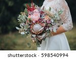 the bride in a white dress is... | Shutterstock . vector #598540994