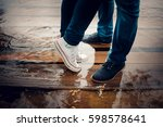 feet in sports shoes stand in... | Shutterstock . vector #598578641
