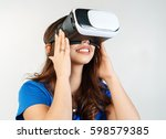 girl wearing a virtual reality... | Shutterstock . vector #598579385