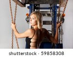 young woman in a black dress and a fork lifter - stock photo