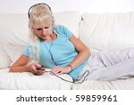 blond woman listening to her... | Shutterstock . vector #59859961