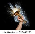 man holding up a gold trophy... | Shutterstock . vector #598641275
