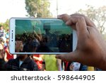 Small photo of HYDERABAD,FEBRUARY 19:Man shoot video with smartphone, a group of people doing aerobic exercise,outdoors ,early morning time on February 19,2017 in Hyderabad,India
