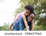 african american father and... | Shutterstock . vector #598657964
