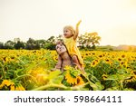 mom and daughter in the field... | Shutterstock . vector #598664111