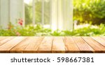 empty wood table top on blur... | Shutterstock . vector #598667381