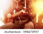 an unrecognizable musician... | Shutterstock . vector #598673957