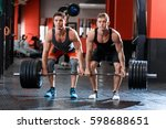 two muscular athletes raise the ... | Shutterstock . vector #598688651