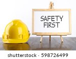 safety helmet and white board... | Shutterstock . vector #598726499
