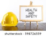 safety helmet and white board... | Shutterstock . vector #598726559
