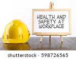 safety helmet and white board... | Shutterstock . vector #598726565