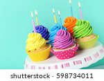 tasty cupcakes on cake stand on ... | Shutterstock . vector #598734011