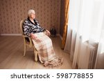 Alone Old Woman Sitting In A...